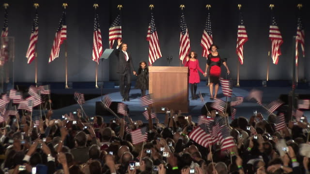 stockvideo's en b-roll-footage met november 4, 2008 crowd in grant park cheering as barack obama takes the stage with wife michelle and daughters malia and sasha after winning the... - verkiezing