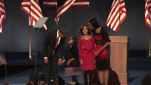 stockvideo's en b-roll-footage met november 4 2008 ws barack obama waving to crowd in grant park with wife michelle and daughters malia and sasha after winning the presidential... - 2008