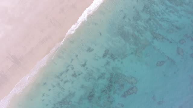 australia_drone_australia_16_4k_drone_broome_kimberleys_sand_beach_red_cliff - purity stock videos & royalty-free footage