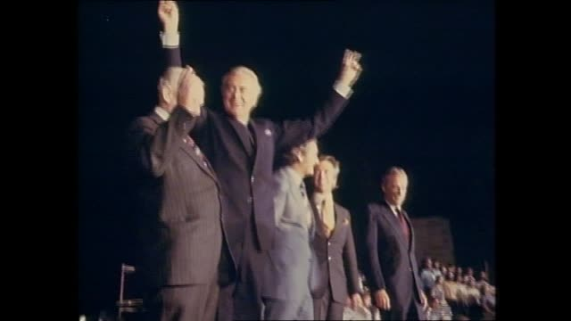 alp election rally night crowd with candles natsot whitlam speech heard / natsot crowd chants we want gough gough whitlam on stage greets don dunstan... - bob hawke stock videos and b-roll footage
