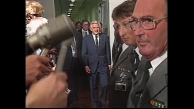prime minister bob hawke walks parliament house corridor to alp party room meeting – smiling / alp mp john scott leaves and talks a drovers dog could... - bob hawke stock videos and b-roll footage