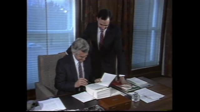 hawke in parliament / shakes hands with bill hayden / young keating out of car / hawke and hayden presser / hawke and hazel 1983 election win / hawke... - bob hawke stock videos and b-roll footage