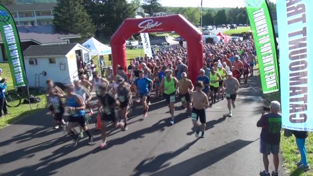 RUNNERS HEAD UP MT MANSFIELD STOWE VERMONT FOR A CHALLENGING MOUNTAIN RACE