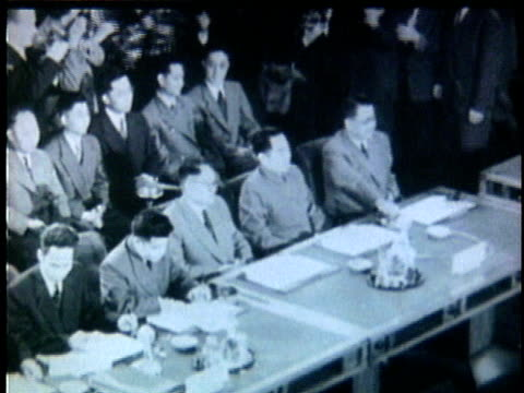 french and viet minh officials sign peace treaty at the geneva conference / geneva switzerland - 1954 bildbanksvideor och videomaterial från bakom kulisserna
