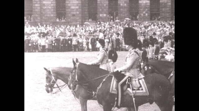 queen elizabeth ii riding a horse side saddle and saluting during a trooping of the color ceremony at horse guard's parade central london june 11 1953 - saddle stock videos and b-roll footage