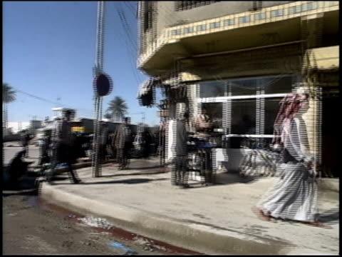 prewar iraq / car pov and ws street scenes / iraq - iraq stock videos and b-roll footage