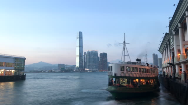 star ferry berthing in central at sunset - star ferry stock videos & royalty-free footage