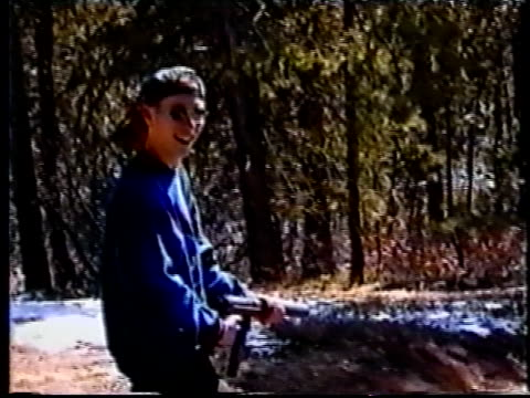 Columbine killer Eric Harris practice shooting gun in woods for video made six weeks before school massacre/ Littleton Colorado USA/ AUDIO