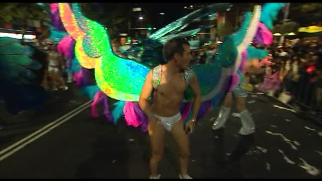 vs sydney mardi gras parade float passes by surf lifesavers in parade dancing male fairies women as cowboys / nations united theme various national... - festivalsflotte bildbanksvideor och videomaterial från bakom kulisserna