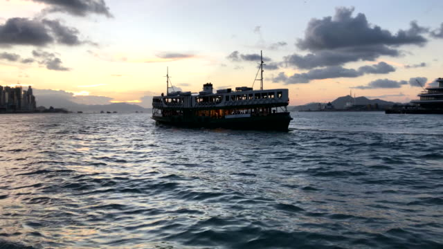 ICONIC FERRY SAILING IN VICTORIA HARBOUR SUNSET
