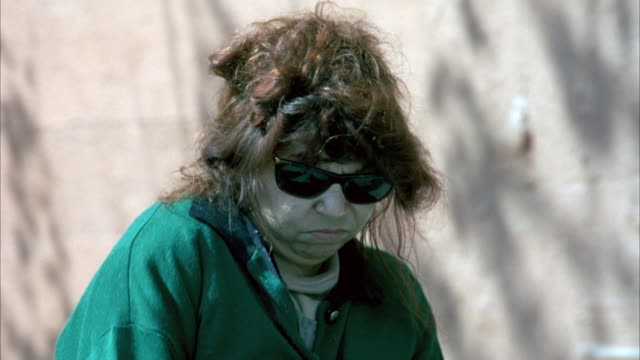 medium angle of homeless woman walking from left to right. - 1990 1999 stock videos & royalty-free footage