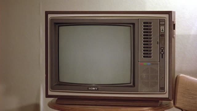 wide angle of television from eighties in room. several buttons on right side. burn-ins or screens. - tv screen stock videos and b-roll footage