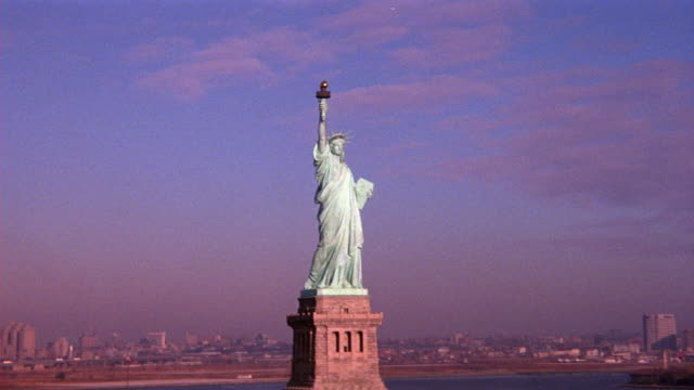 aerial of statue of liberty, land with buildings behind. - 1989 stock videos and b-roll footage
