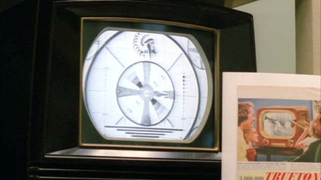 close angle shot of televisions with test pattern displays. see camera pan from right to left and down to show different model 1950's style televisions. - test pattern stock videos & royalty-free footage