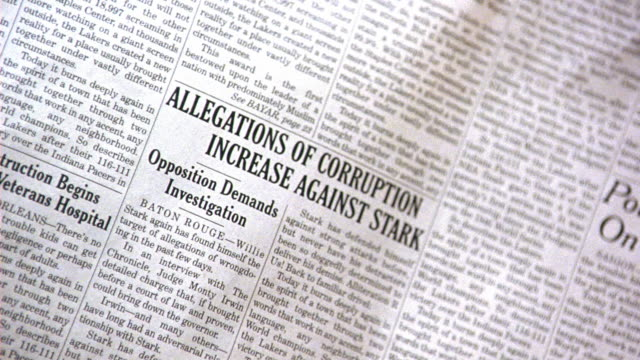 close angle on newspaper headline - allegations of corruption increase against stark - opposition demands investigations - 記事点の映像素材/bロール