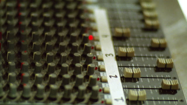 close angle of audio or sound board in radio station or production studio. - radio studio stock videos & royalty-free footage