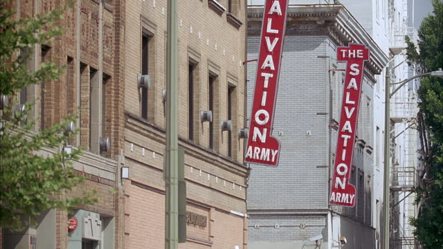 medium angle of signs on building that reads the salvation army. - salvation army stock videos & royalty-free footage