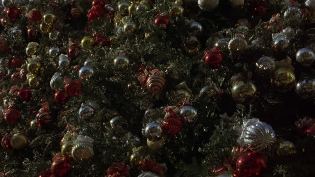 pull back and zoom in on christmas decorations on a christmas tree. actual location the grove - 189 the grove drive, fairfax, los angeles. - the grove los angeles stock videos & royalty-free footage