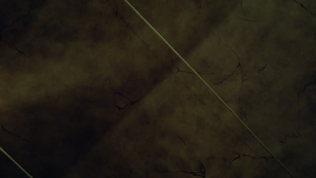 up angle of flashlight searching across stone ceiling or wall. marble. search lights. - marble wall stock videos and b-roll footage