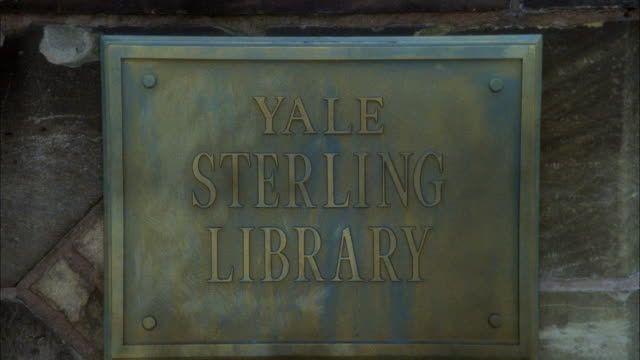 CLOSE ANGLE OF PLAQUE FOR YALE STERLING LIBRARY.