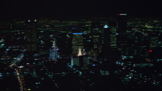 aerial of downtown los angeles skyline. pov moves to left. - anno 1983 video stock e b–roll