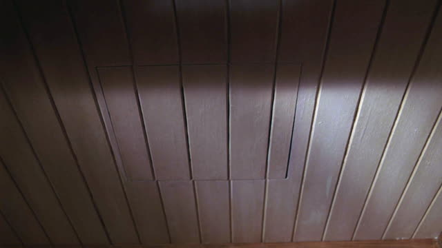 up angle of trap door or entrance to attic in wood ceiling. - 屋根裏部屋点の映像素材/bロール