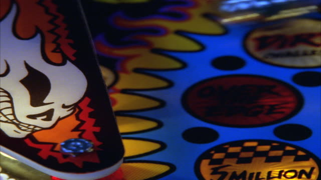 close angle of pinball machine or game. see lights flashing and pinballs bouncing off flippers. neg cut. - pinball machine stock videos & royalty-free footage