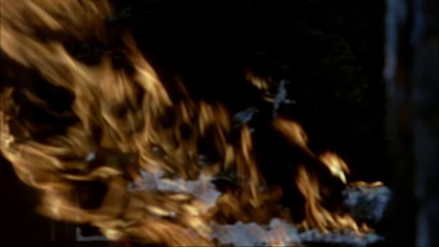 medium angle of barn interior engulfed in flames, on fire. see burning wooden beams, stone walls, wood catwalks, baskets, and jars. - 1914年点の映像素材/bロール