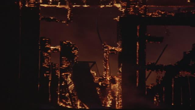 medium angle of barn doorway burning and glowing red from flames. see top of doorway already burned away. fires. - glowing doorway stock videos & royalty-free footage