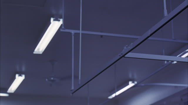 up angle pan of hospital ceiling with fluorescent lights, guide rails for curtains. - fluorescent stock videos & royalty-free footage