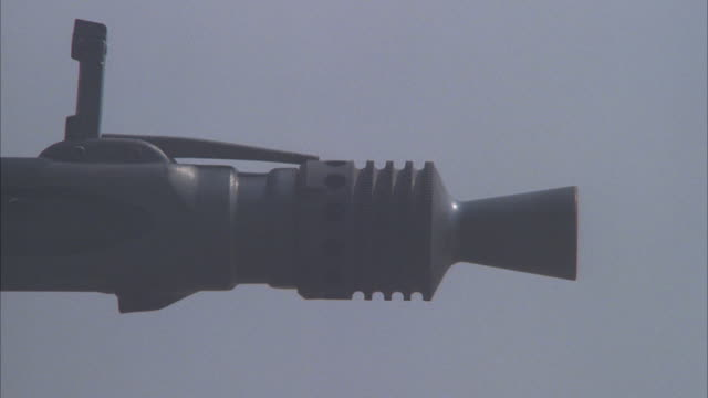 close angle of tank cannon which fires shot across screen from left to right. - cannon stock videos & royalty-free footage