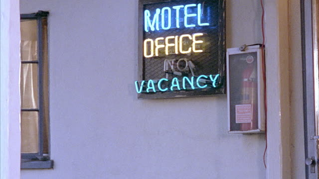 medium angle of neon sign of motel reading motel - kitchens. - marin stock videos & royalty-free footage