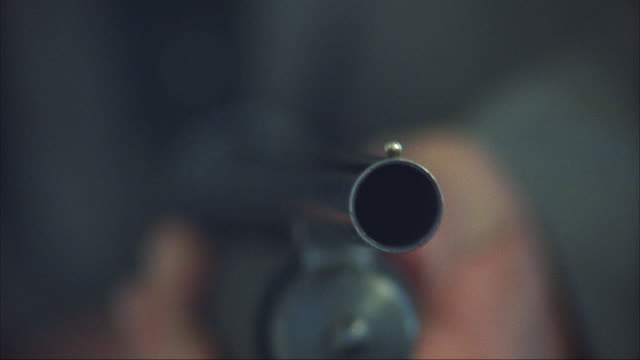 close angle of shotgun gunfire five times by hand. hand cocks shotgun as shell falls out from left. insert. - arma da fuoco video stock e b–roll