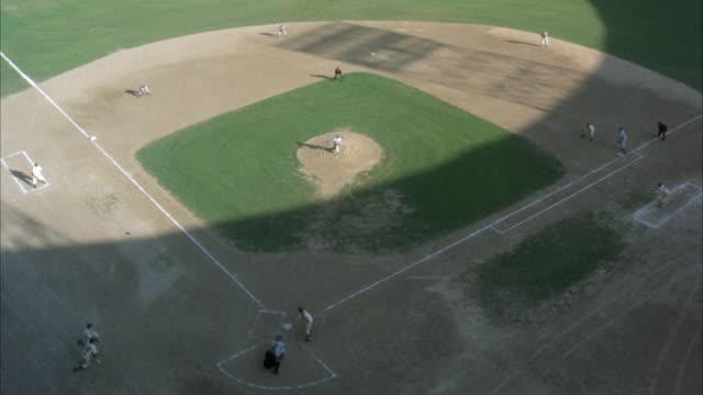 high angle down of baseball diamond with game in progress. shadow covers half of diamond. neg cut. - anno 1939 video stock e b–roll