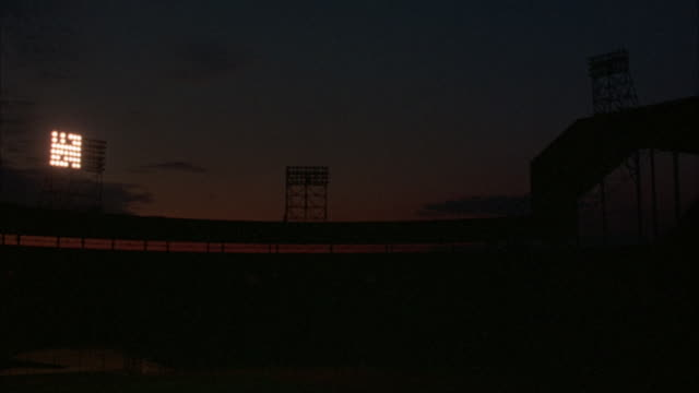 wide angle of baseball stadium. left lights turn on, then center and right lights. sky looks like sunset. - buffalo new york state stock videos & royalty-free footage