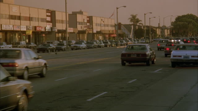 medium angle of city street in urban area, stores in background. - inglewood video stock e b–roll