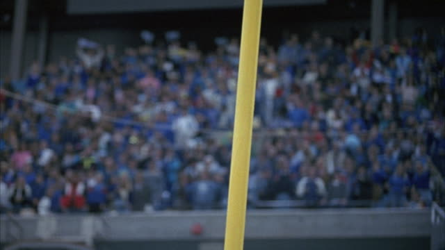 close angle of field goal post with blurry crowd at stadium in background. football comes in just to right of upright, could be just good or just no good. insert. - football goal post stock videos and b-roll footage