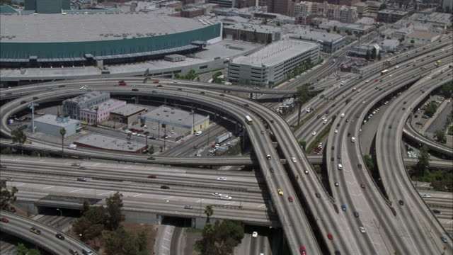 AERIAL OF I-110 (HARBOR FREEWAY) AND I-10 (SANTA MONICA FREEWAY) INTERCHANGE. PANS RIGHT TO HIGHWAY AT END.