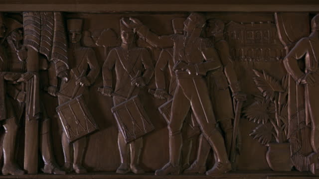 pan left to right of louisiana history and life a frieze at the louisiana state capitol building in bating rouge.  the sculpture depicts law and justice in louisiana.  napoleon presents the napoleonic law. - kapitol von louisiana stock-videos und b-roll-filmmaterial