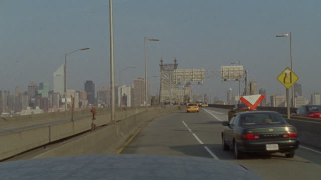 hand held driving pov going across the manhattan bridge toward the new york city skyline. - 2001 stock videos and b-roll footage