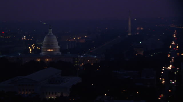 medium angle aerial of washington dc skyline at dusk. see capitol and washington monument in center. - washington dc stock videos & royalty-free footage