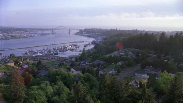aerial of city of newport oregon and yaquina bay. coast. bridge. forests and marinas visible. - newport oregon stock videos & royalty-free footage