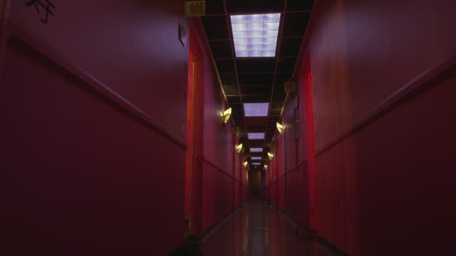 wide angle of hallway lit in pink lights.  could be a brothel, massage parlor, cheap hotel or motel. corridors. - motel stock videos & royalty-free footage