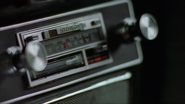 vídeos y material grabado en eventos de stock de close angle of car stereo. hand inserts and ejects cassette tape into jack six times. hand changes to woman's hand to man's hand every other time. insert. - 1990