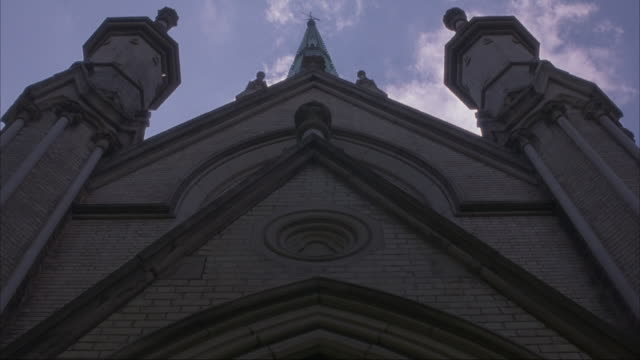 up angle of entrance and steeple of church or cathedral. could be college or university building. - architectural feature stock videos & royalty-free footage