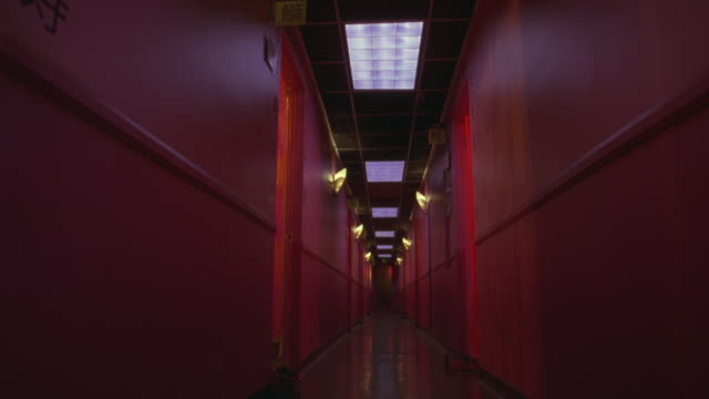 wide angle of hallway lit in pink lights.  could be a brothel, massage parlor, cheap hotel or motel. corridors. - motel stock videos and b-roll footage