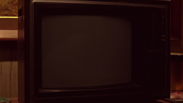 close angle of television set on counter in lower class hotel or motel room. static on screen. - device screen stock videos & royalty-free footage