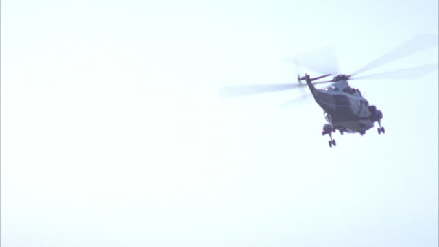tracking shot of military helicopter from jefferson memorial, see sun in sky. helicopter flies around. - military helicopter stock videos and b-roll footage