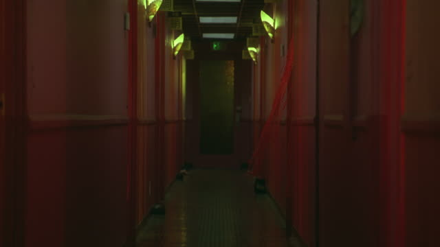 wide angle of hallway lit in pink lights.  could be a brothel, massage parlor, cheap hotel or motel. corridors. - bordell stock-videos und b-roll-filmmaterial