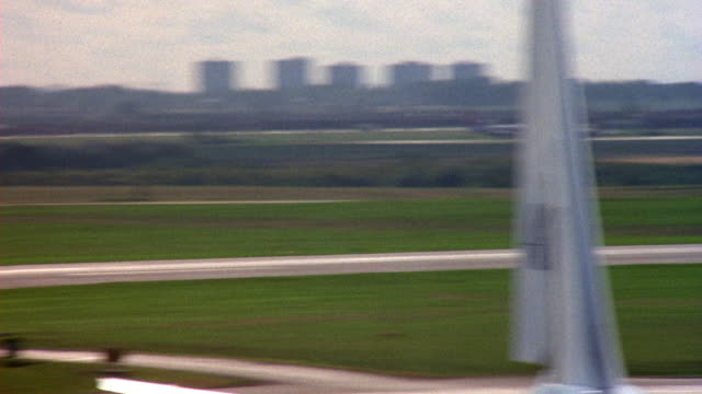 pan left to right of runway at airport to tail of airplane. pov from inside airport terminal. - airplane tail stock videos and b-roll footage